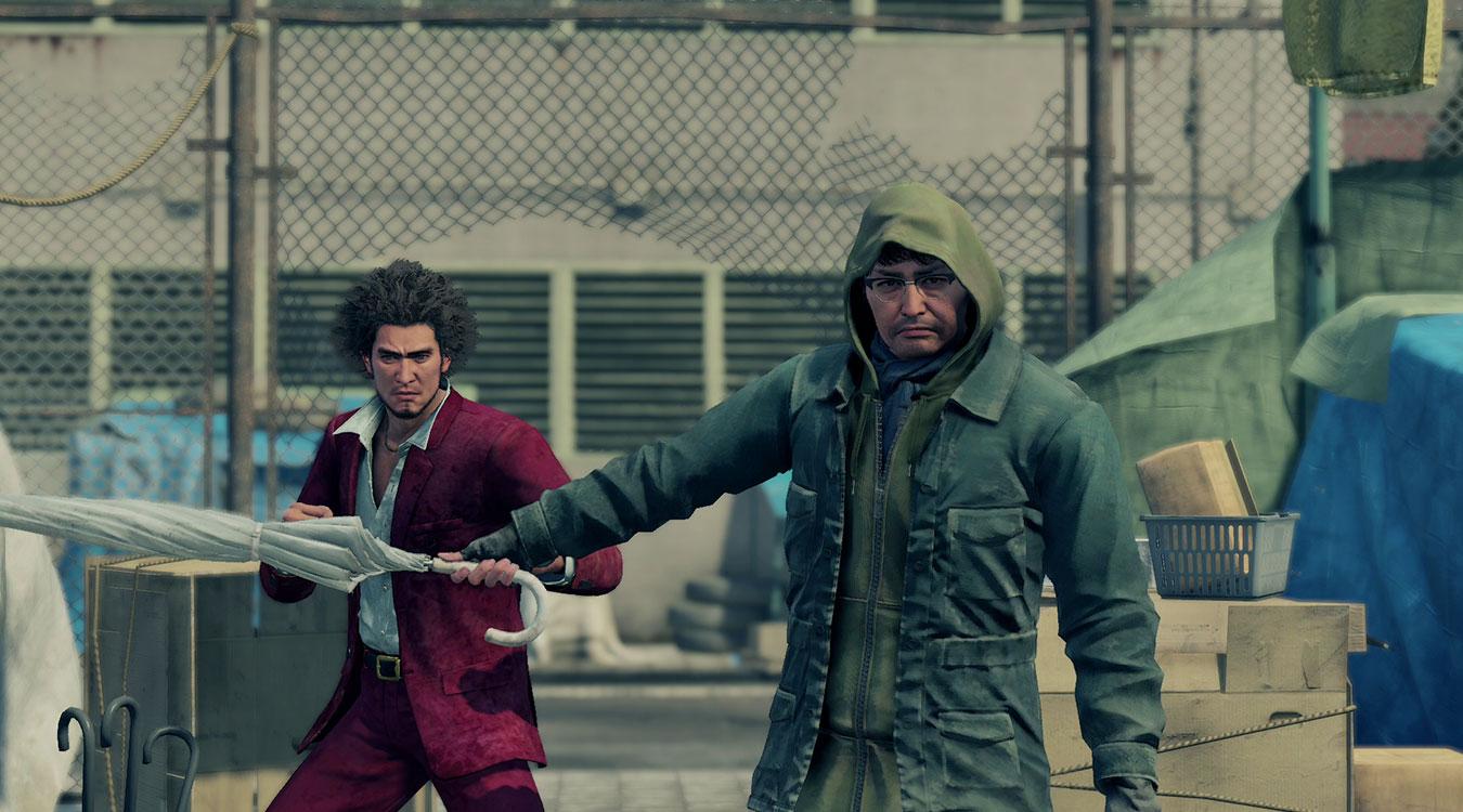 A man holds Ichiban back with a bat in Yakuza Like a Dragon.