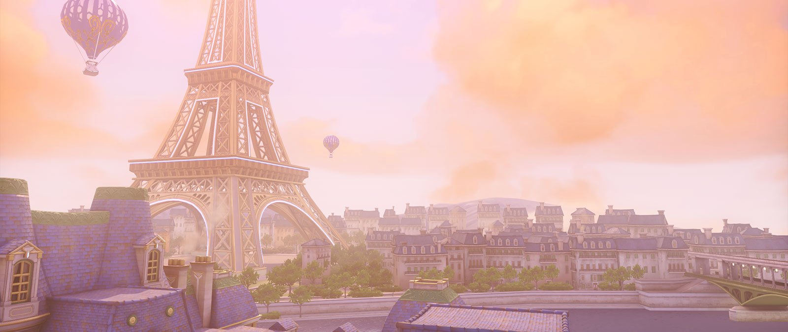 Paris and the Eifel Tower in the sunshine with balloons floating in the sky.
