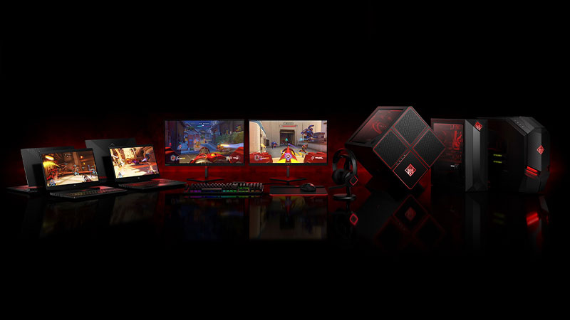 Desktop, laptops, and monitors lined up with red backlighting