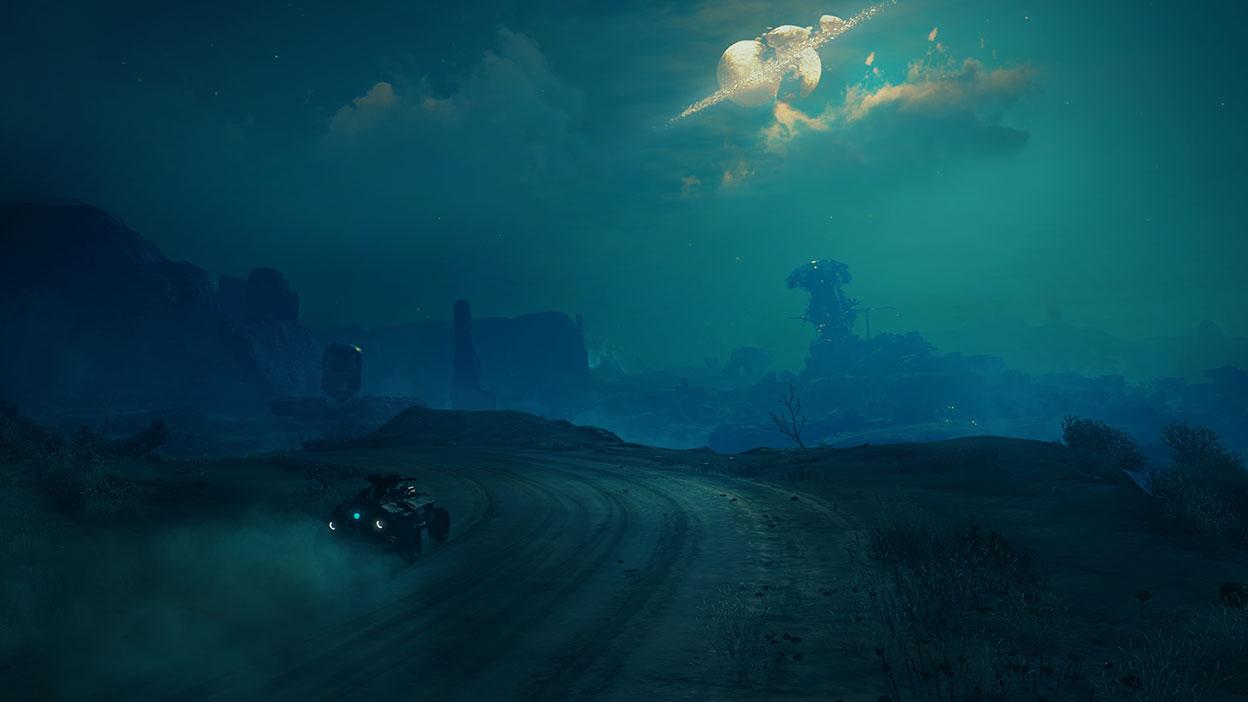 Une voiture parcourant une route abandonnée se dirige vers un paysage désertique.