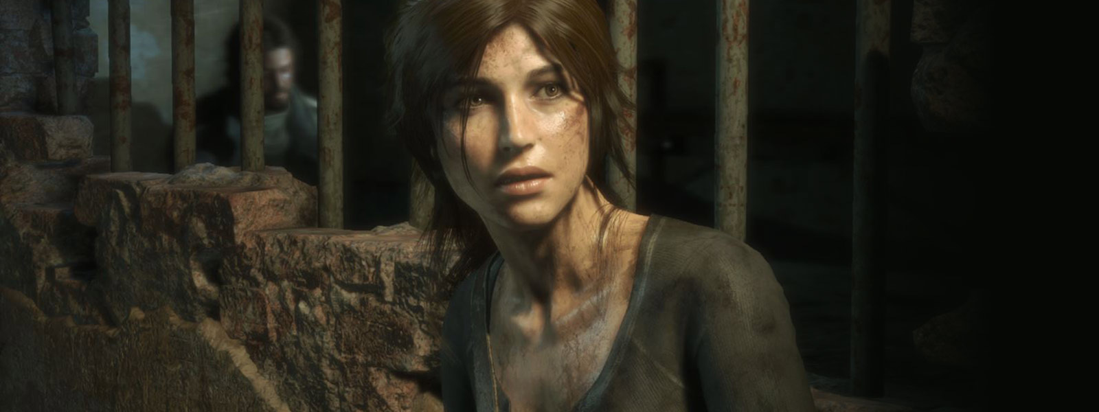 front view of Lara with prison bars behind her