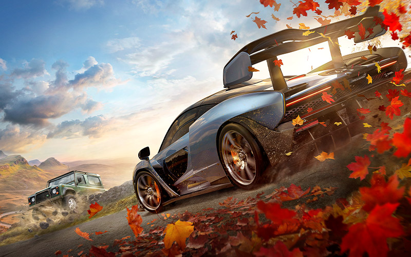 Forza horizon 4 with a McLaren driving though red and yellow leaves