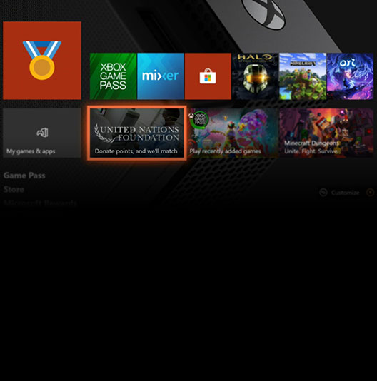 An Xbox One home screen with a panel for the United Nations Foundation highlighted