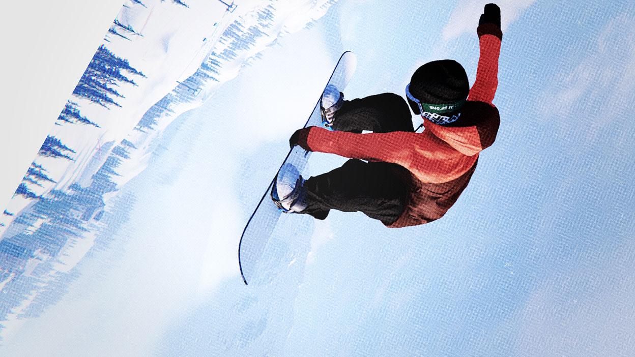 A snowboarder flies sideways through the air holding a grab.