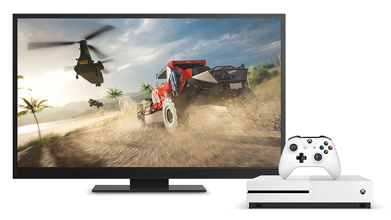 Xbox one s console and a pc screen