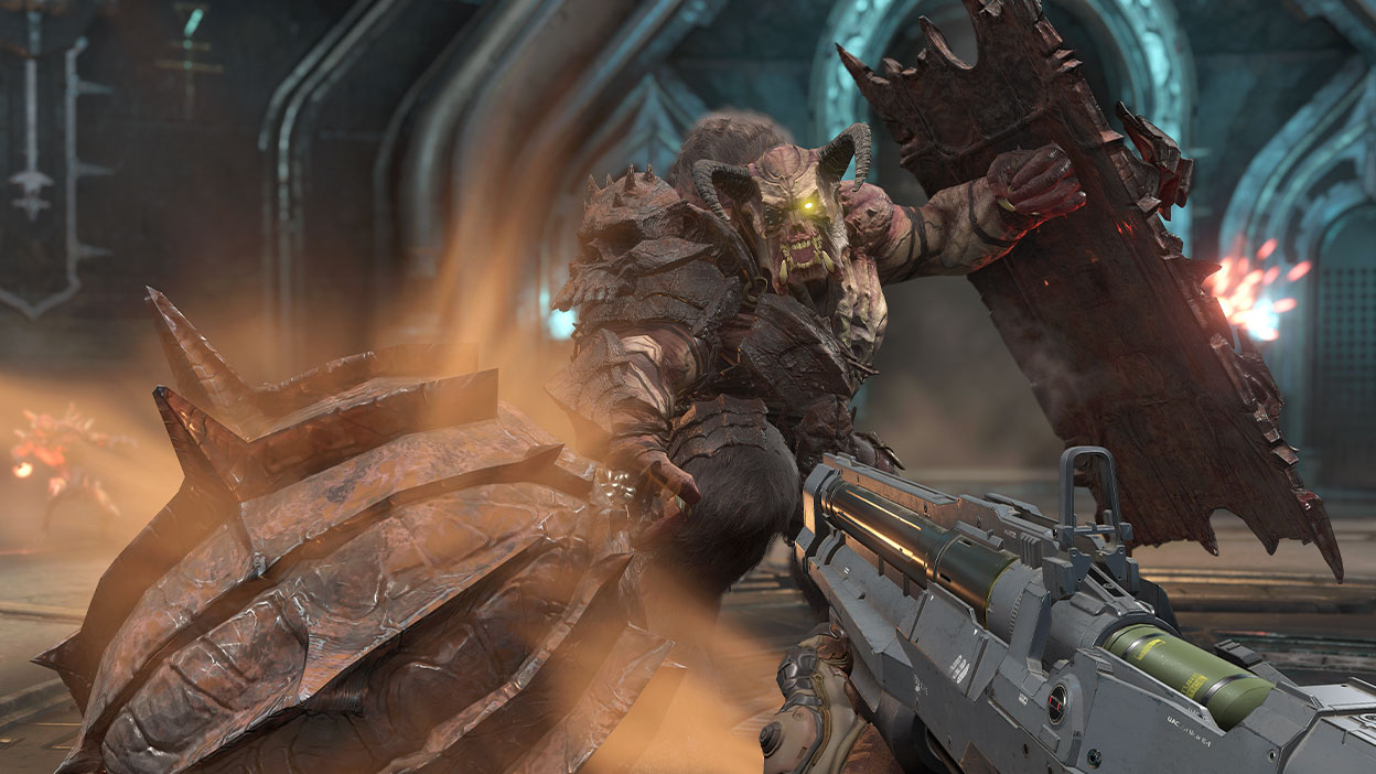 A giant horned monster attacks a player with a gun at the ready.