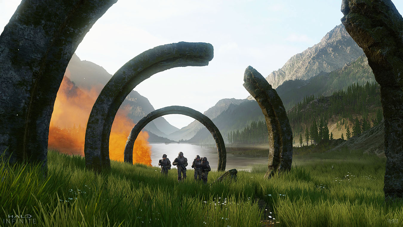 Squad walking beneath rings in a valley