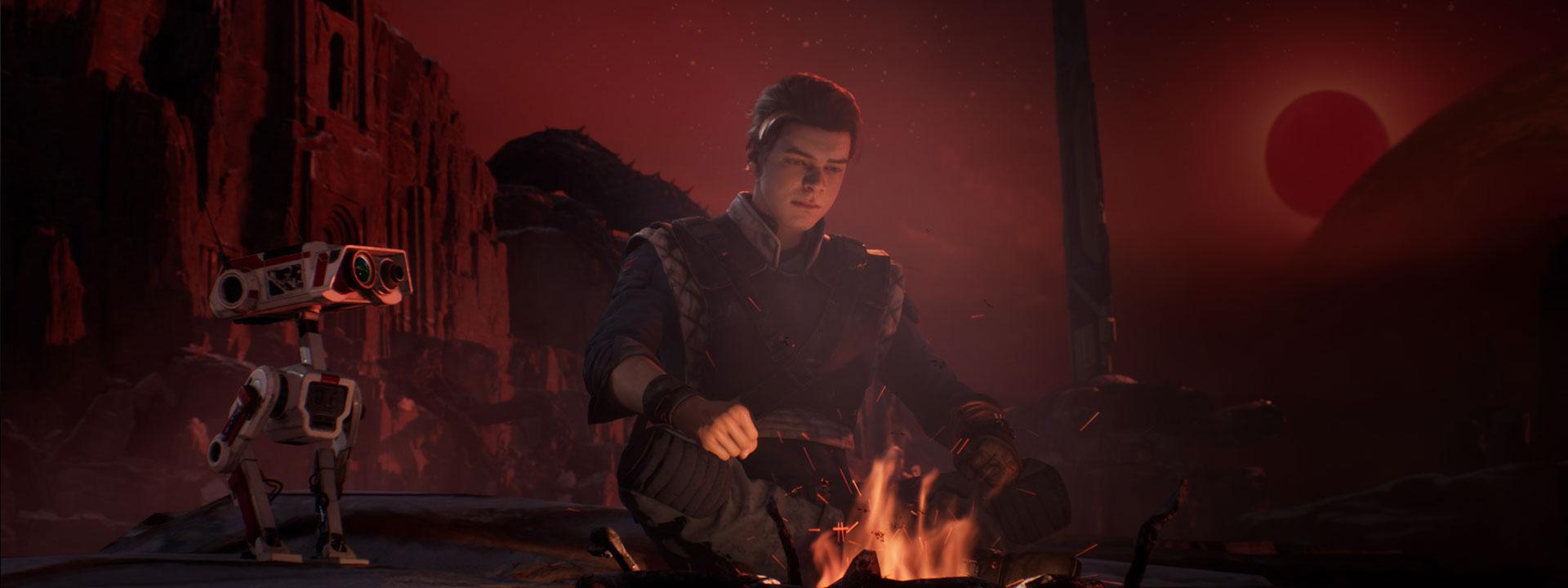 Cal Kestis est assis devant un feu de joie à côté d'un petit droïde