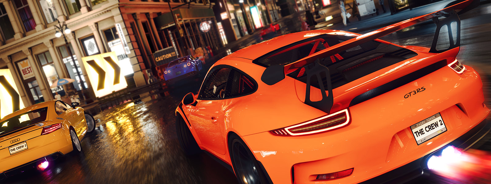 Back of Orange Porsche GT3RS in a street race