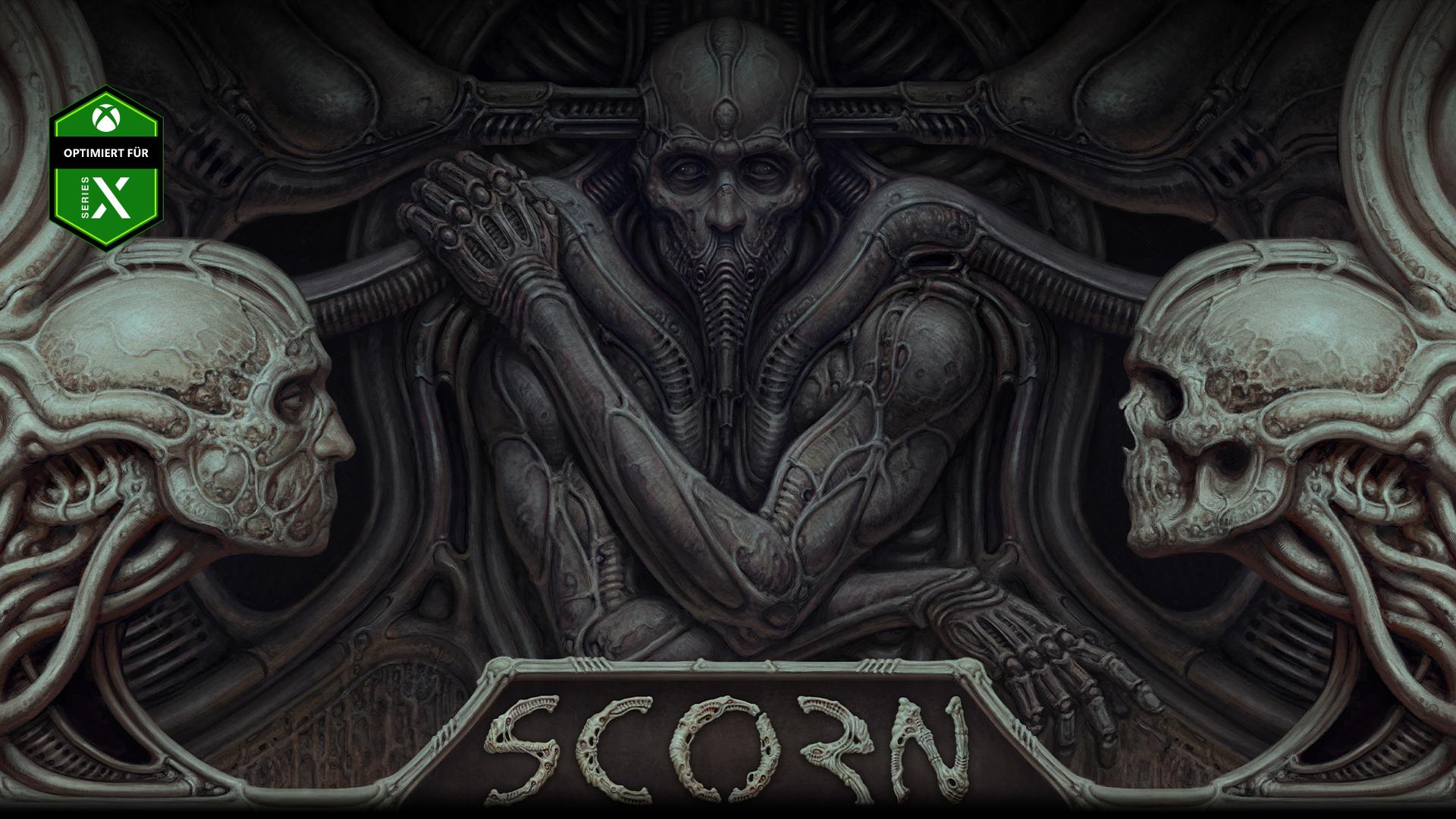 Figur aus Scorn eingebettet in eine Wand mit zwei Schädeln.