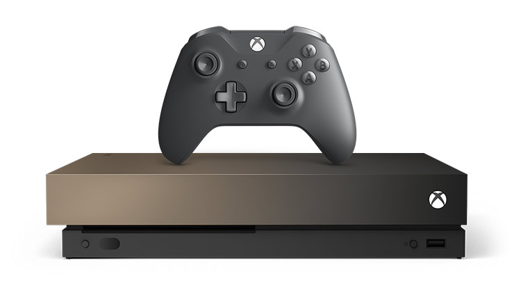 Front view of the Xbox One X Gold Rush Special Edition 1 terabyte with an Xbox Wireless Controller on top