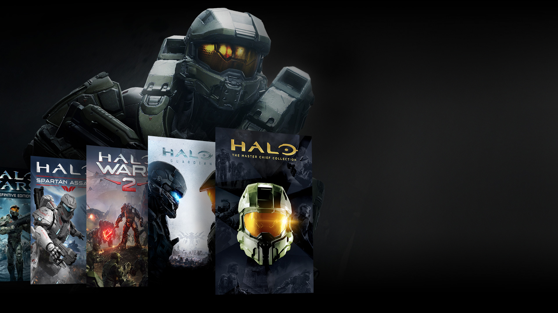Front view of Halo character standing behind collage of Halo games