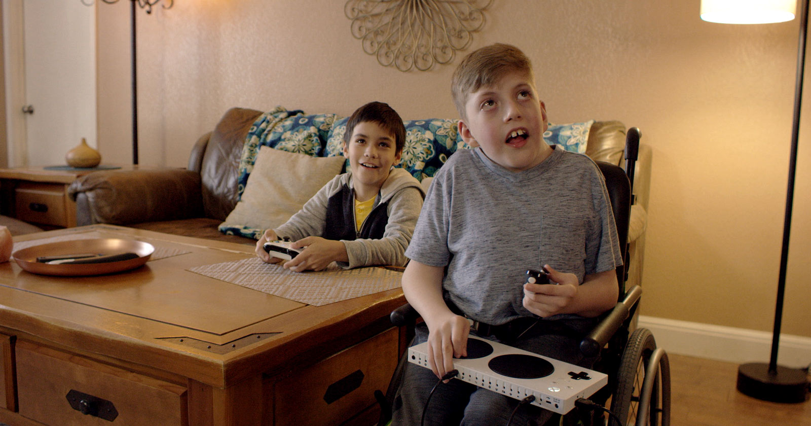 Owen using the Xbox Adaptive Controller with a friend holding an Xbox Wireless Controller
