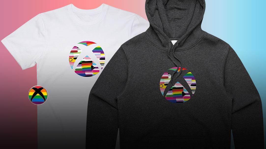 Assortiment d'articles de la gamme Pride Gear: un sweat à capuche, un t-shirt et une épinglette.