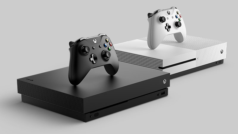 Vista lateral do Xbox One S e Xbox One X