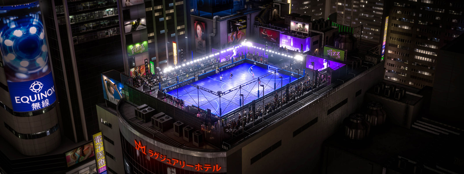 People playing street football on a rooftop cage in Tokyo
