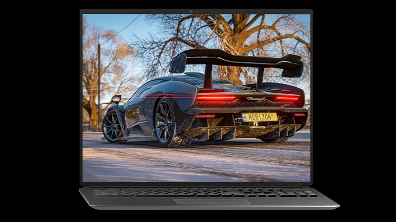 Laptop displaying a Forza Horizon 4 super car in the snow