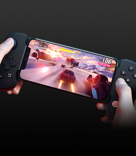 Someone playing a racing game on their iPhone using the Backbone One Controller