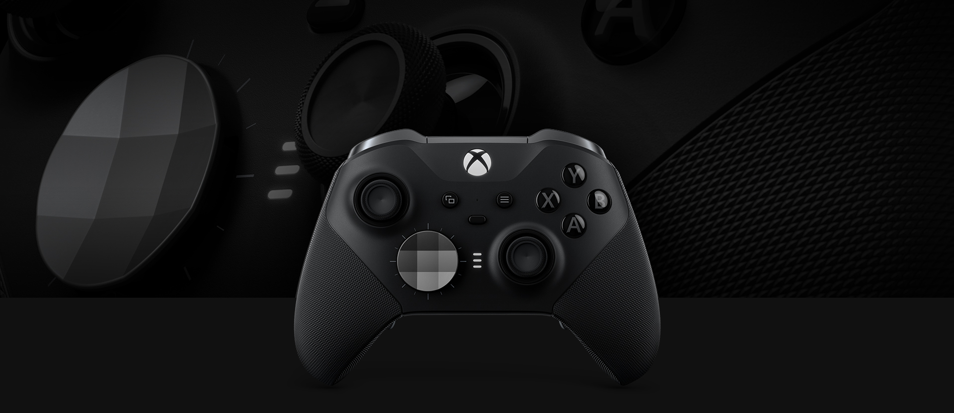 Front view of the Xbox Elite Wireless controller series 2 with a close up of the controller in the background