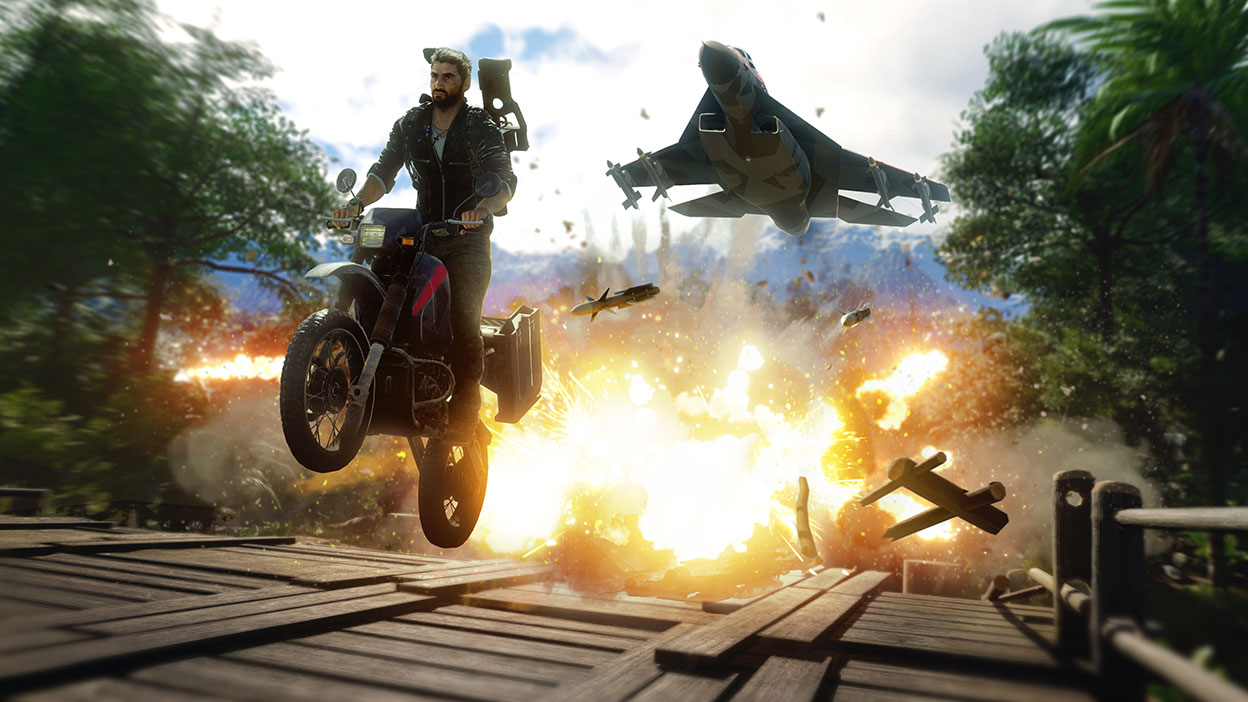 Rico rides a motorcycle while dodging missiles from an aircraft