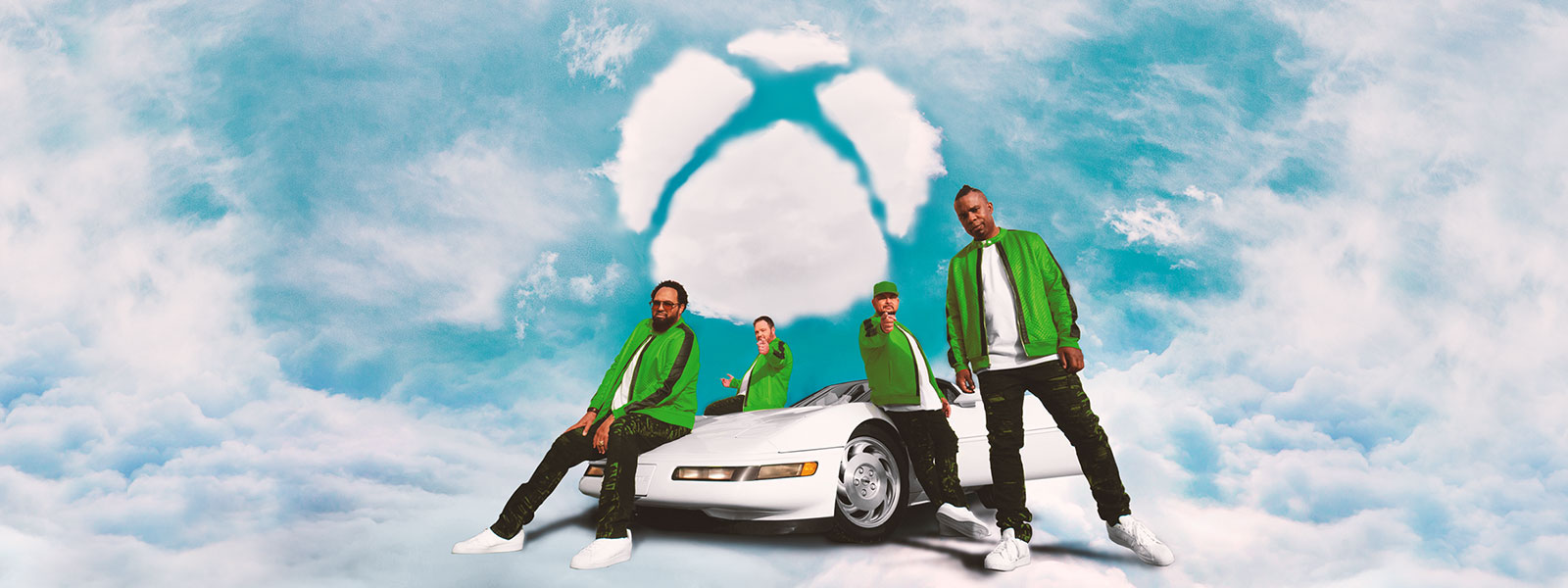 4 R&B singers standing next to a car in the clouds