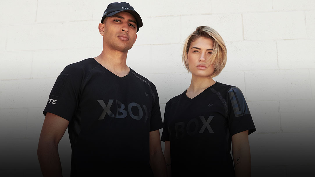 A man and a woman wearing Xbox Elite collection shirts..