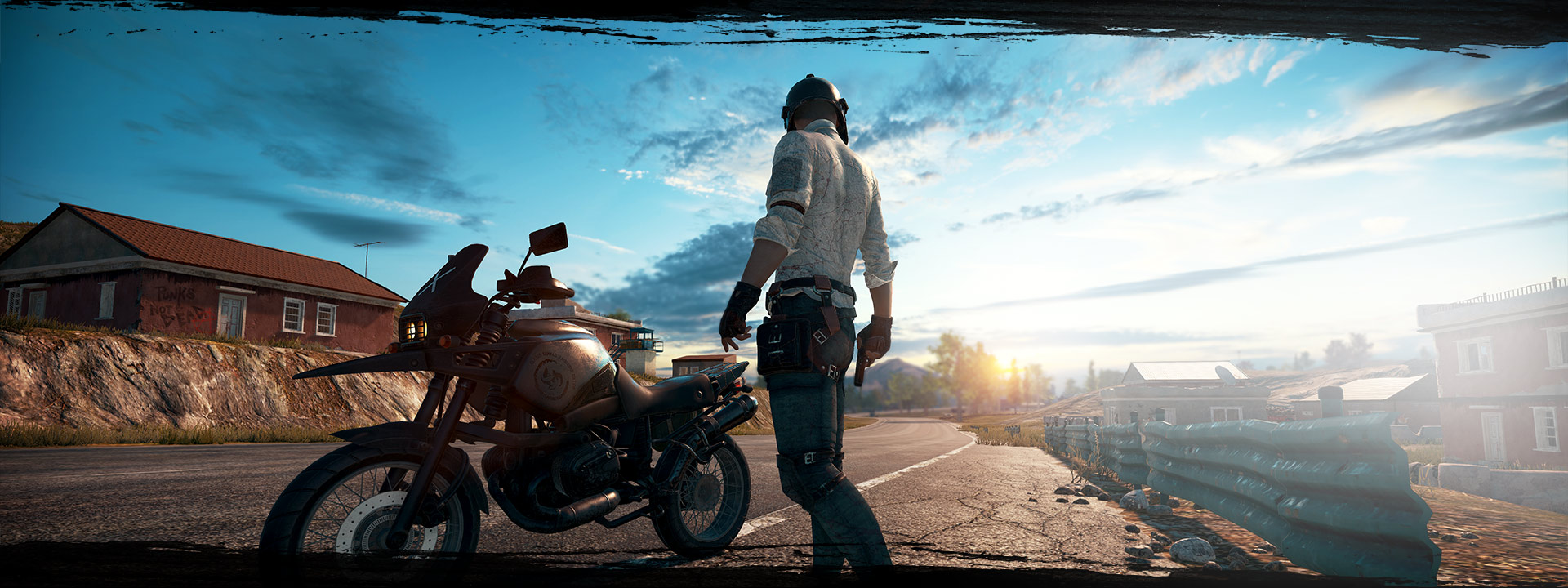 PlayerUnknowns character standing in front of motorcycle in the street with pistol