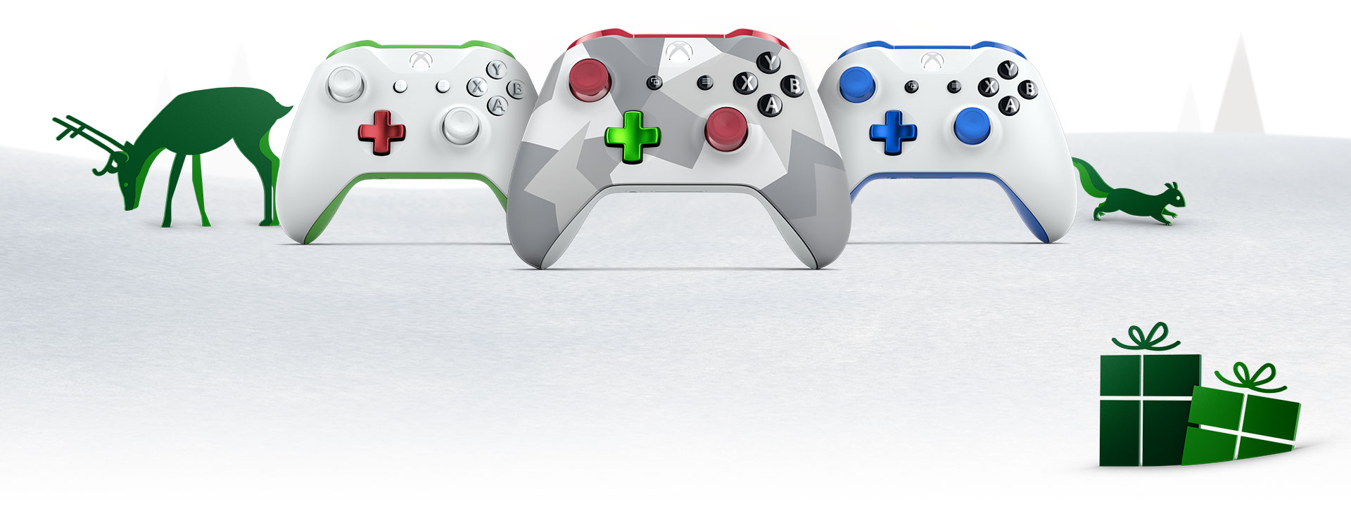 3 Xbox Design Lab controllers on a snowy background with animals and trees