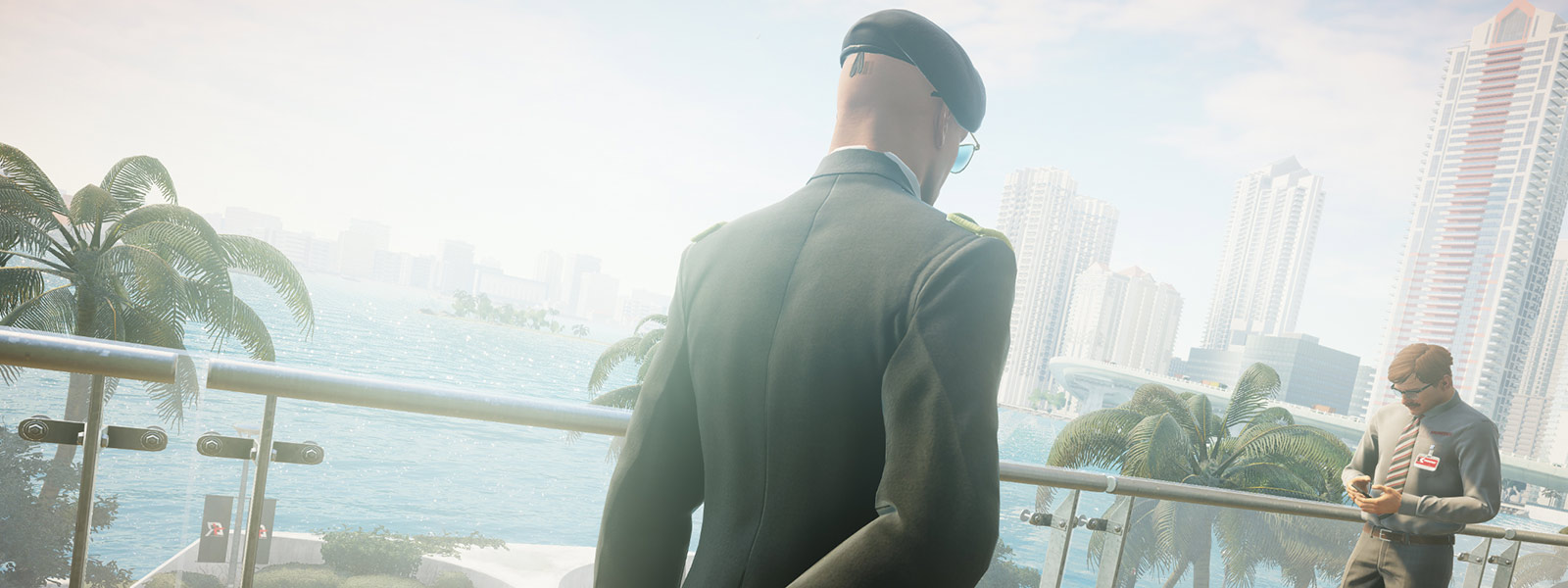 Back view of Agent 47 standing near a racetrack worker in a suit and tie