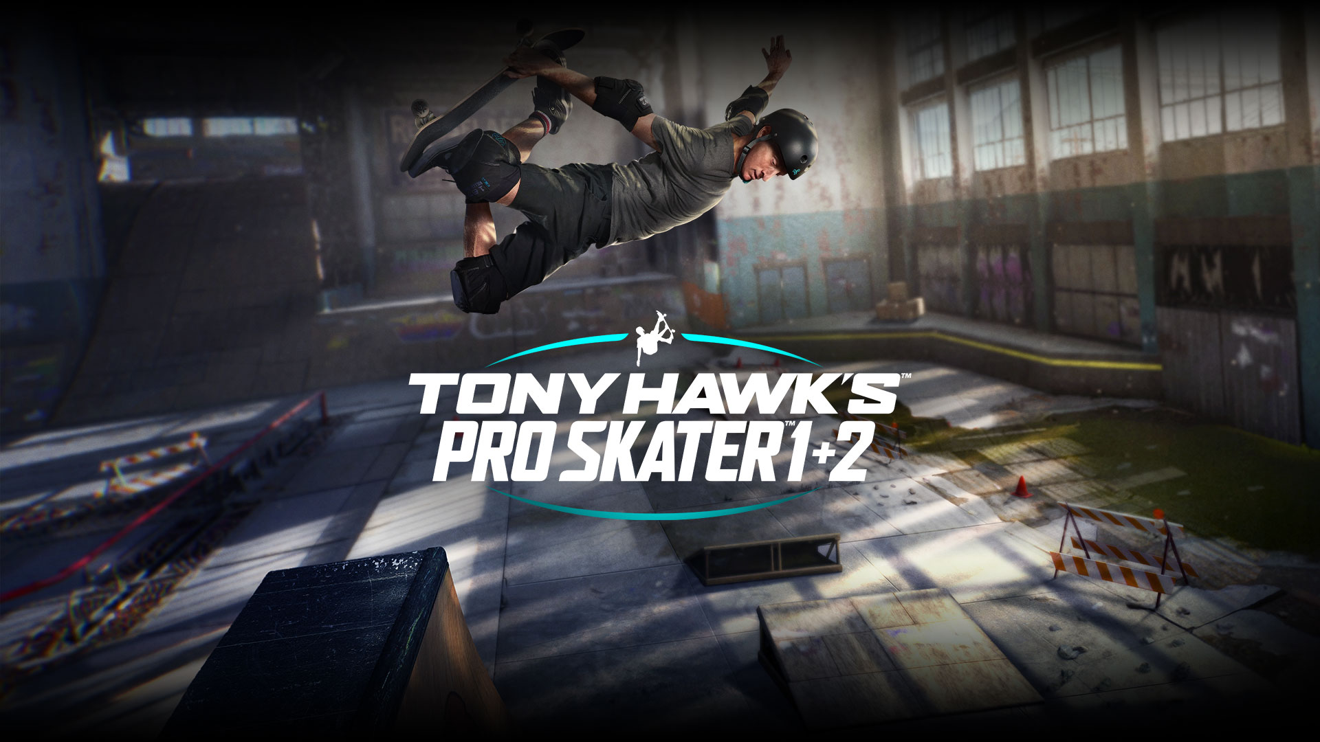 Tony Hawk's Pro Skater 1 + 2, Tony Hawk rides a skateboard in a warehouse.