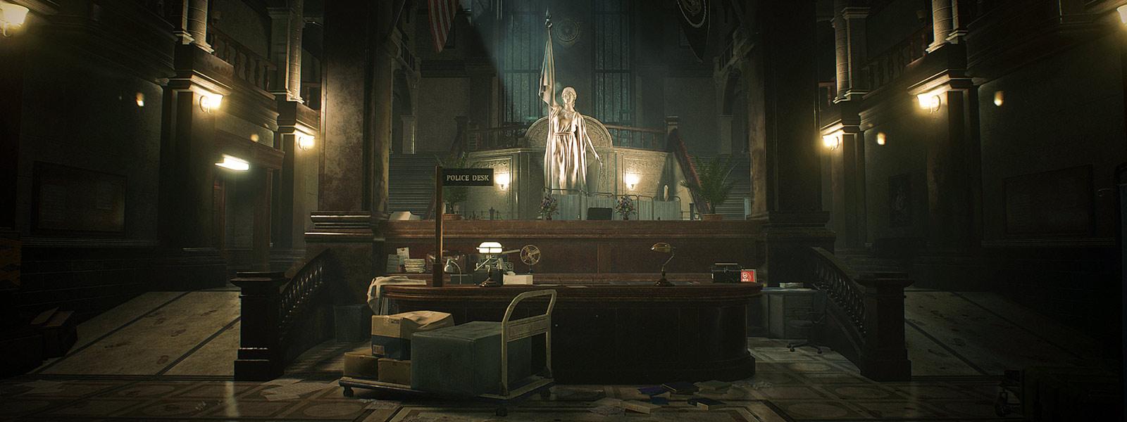 Pohľad na recepčný pult a sochu vnútri policajnej stanice v Raccoon City