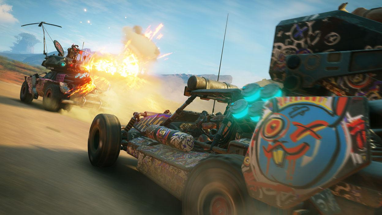 Deux véhicules robustes, couverts de graffitis, en plein combat.