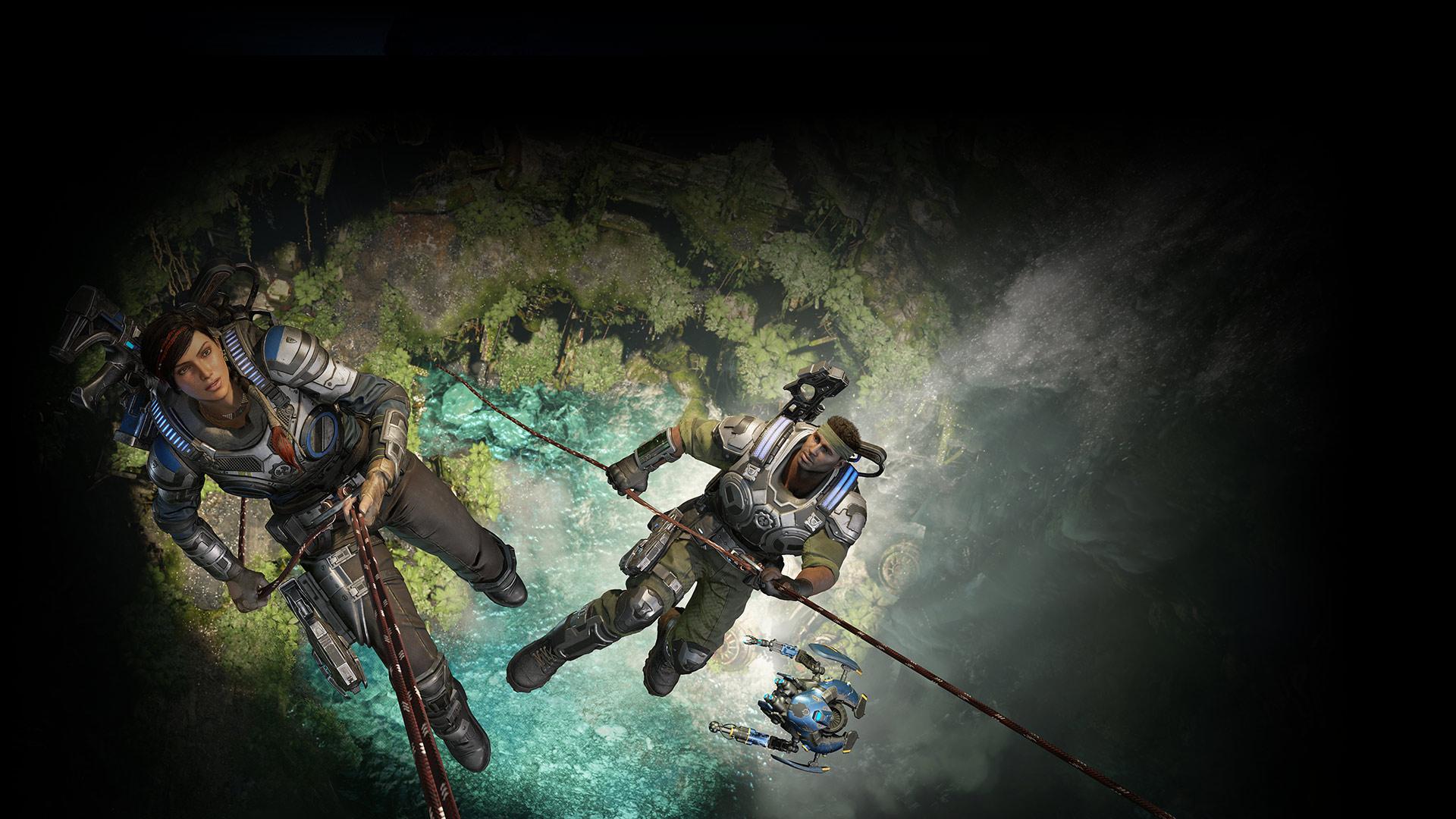 Kait y Del descienden un acantilado con cuerdas