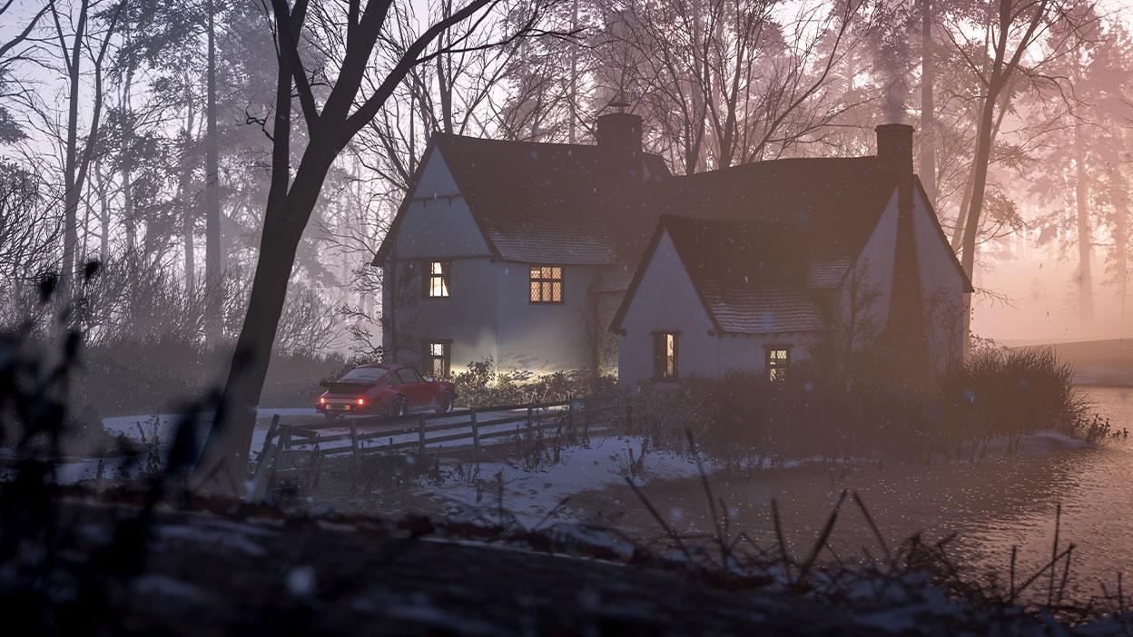 Una tranquila casa de campo al lado de un lago, durante el amanecer, con nieve y luces que brillan por la ventana