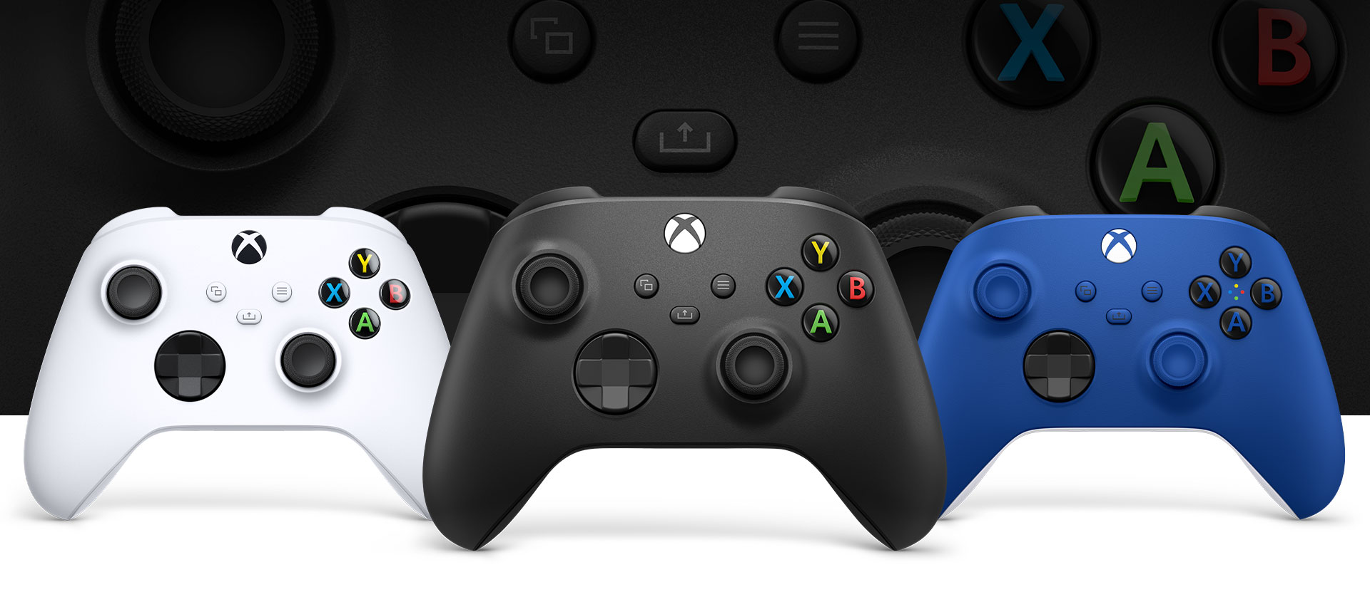 Xbox Carbon Black controller in front with the robot white and shock blue beside it