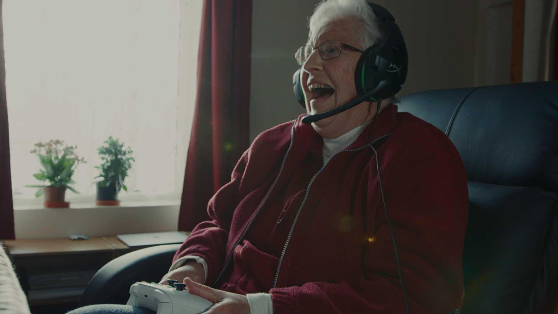 An image of Mary playing Xbox, with the quote