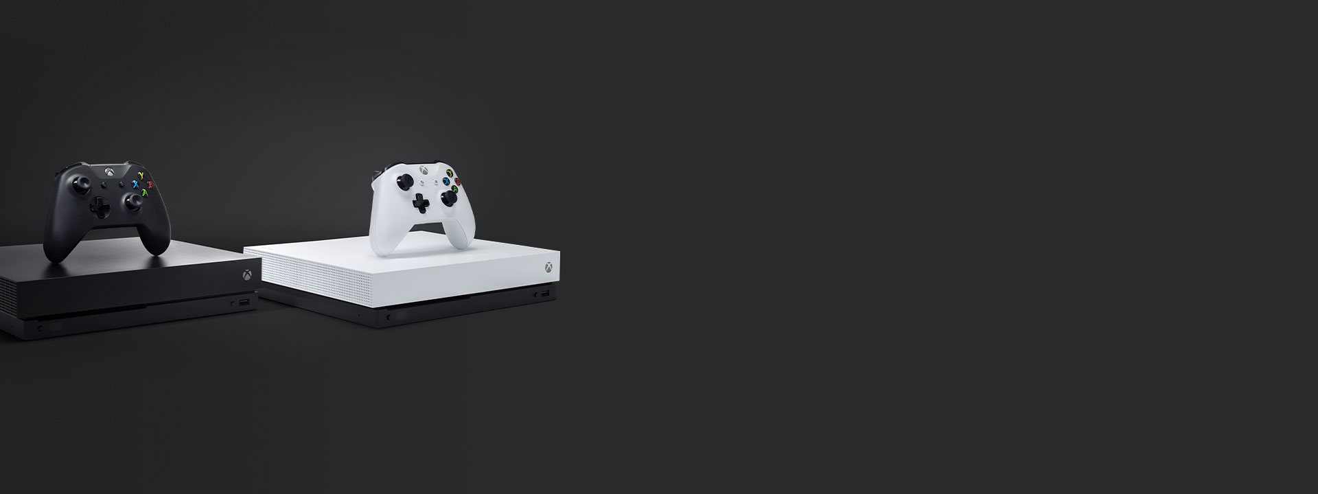 Xbox One X and Xbox One X Robot White Special Edition consoles on a dark grey background