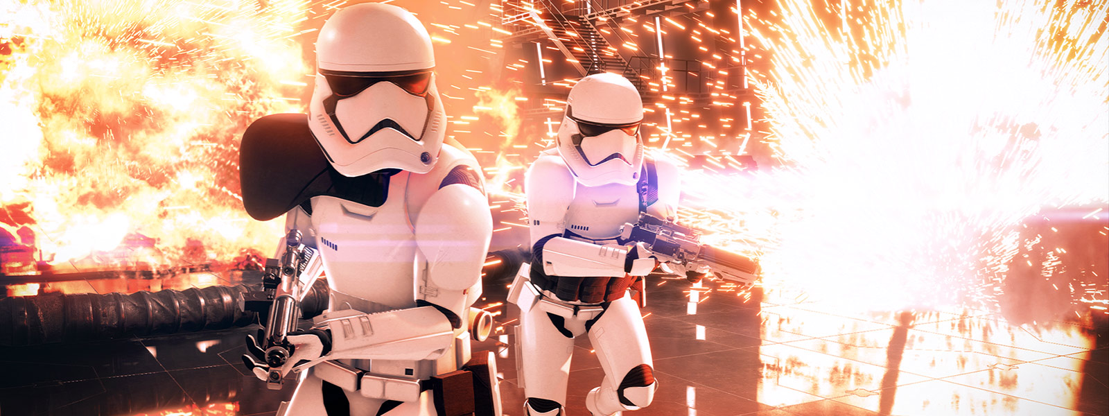 Front view of two Stormtroopers running through a base blowing up with multiple explosions