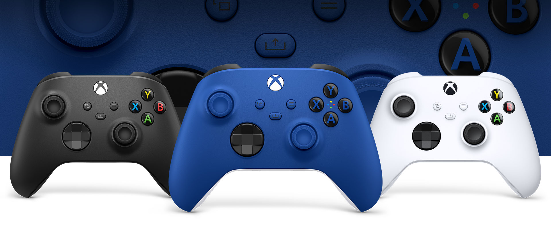 Xbox Shock Blue controller in front with the robot white and Carbon Blue controllers beside it