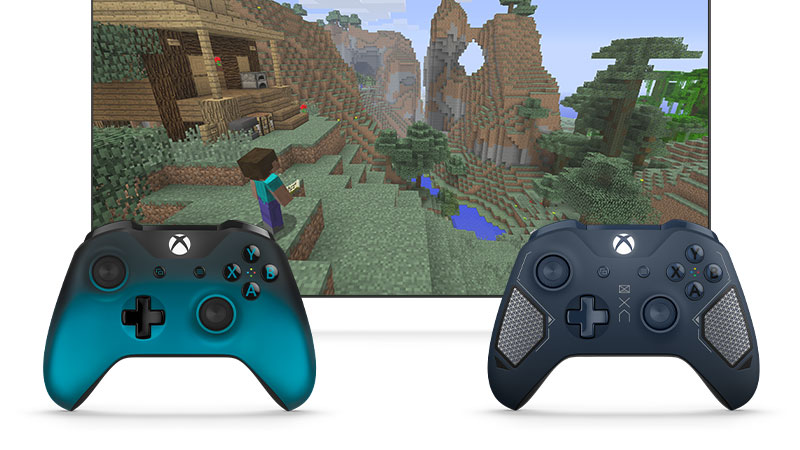 Two Xbox controllers in a standing upright in front of a screen showing a scene from Minecraft