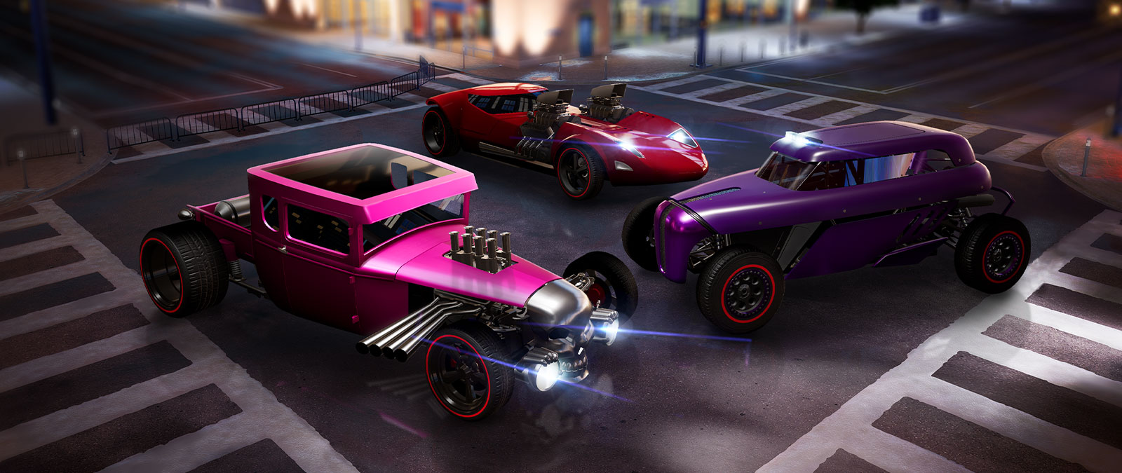 Three Hot Wheels cars in the middle of a junction