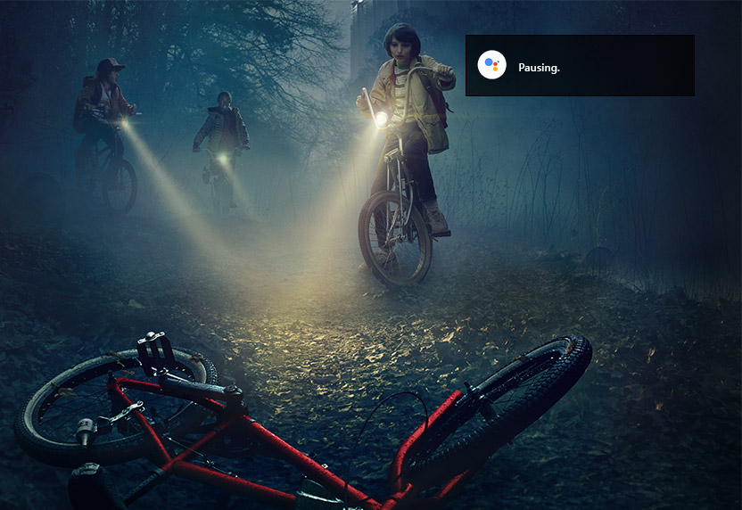 Screenshot of Stranger Things with a Google Assistant play notification