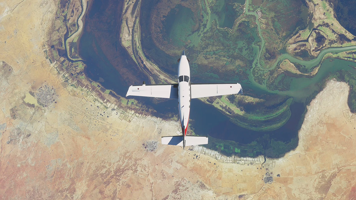 Plane from Microsoft Flight Simulator flying above land and water
