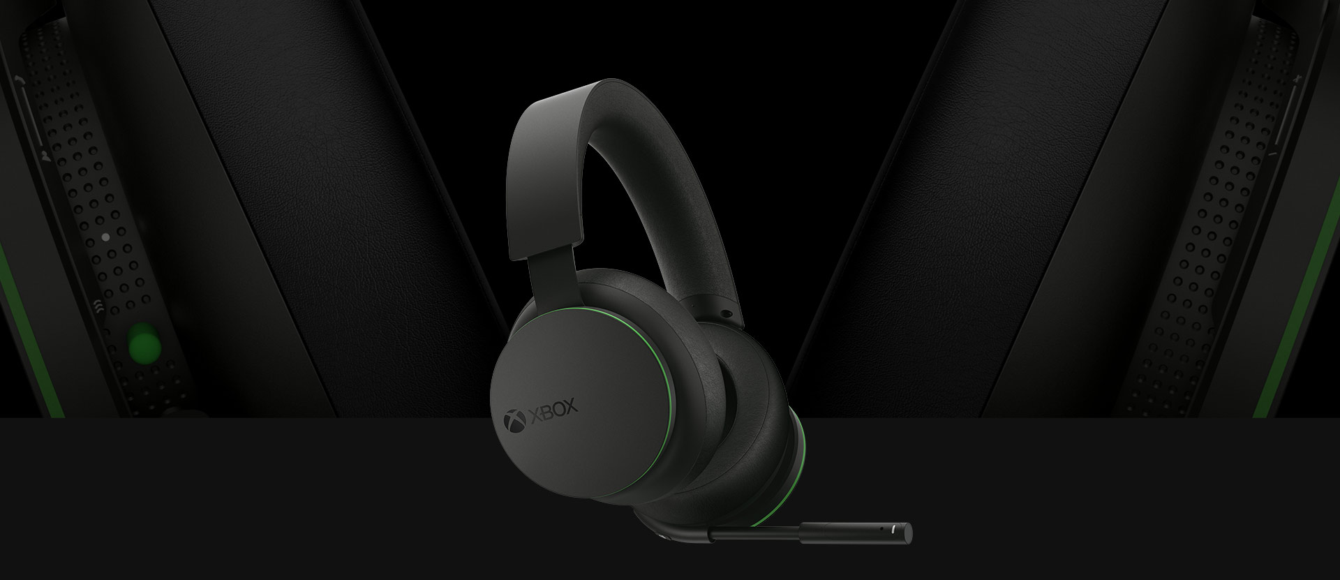 Front angled view of the Xbox Wireless Headset. A larger detailed view of the earcups is pictured behind the headset.