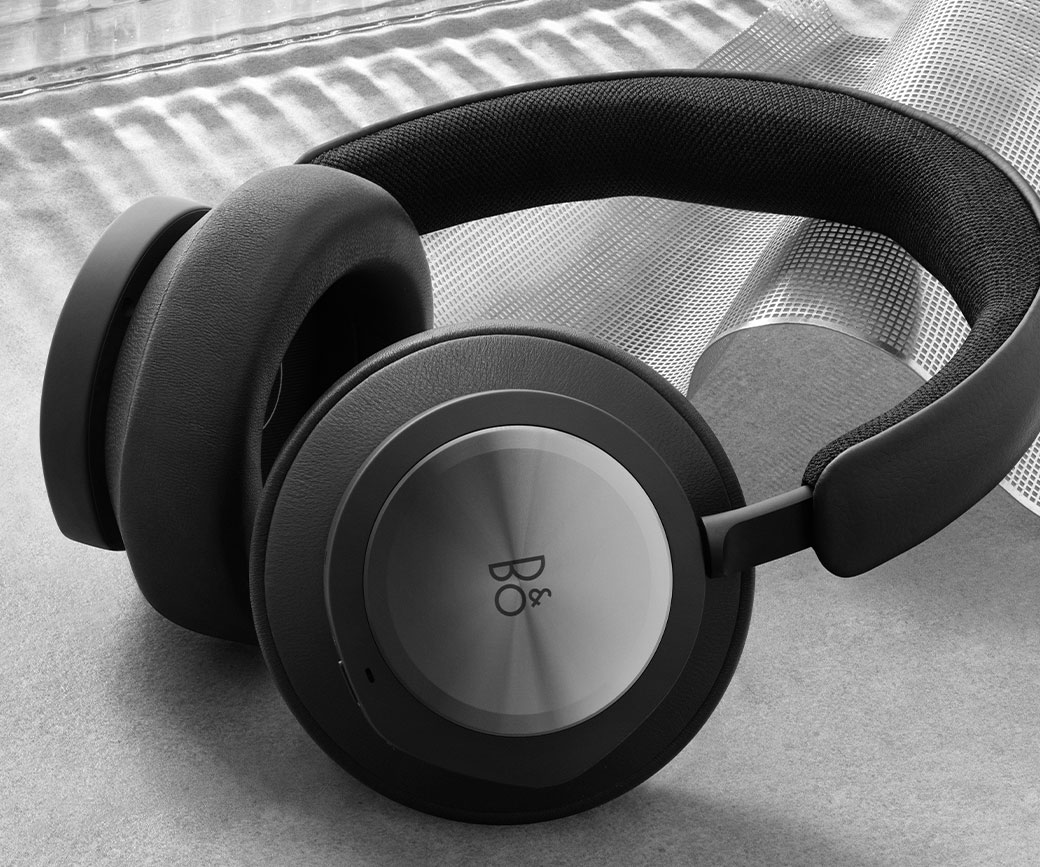 Close up angled view of the Bang and Olufsen black headset