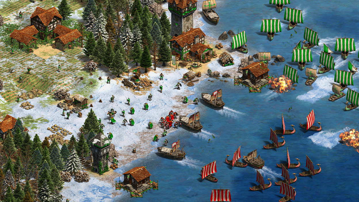 A red army with ships invading a snowy shore while a green army flanks and attacks at the same time.