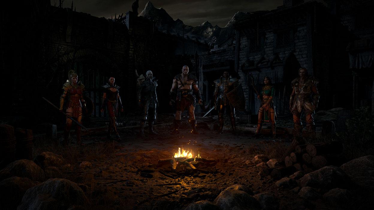 Tous les différents choix de personnages posent devant un feu de camp dans un lieu en ruine.