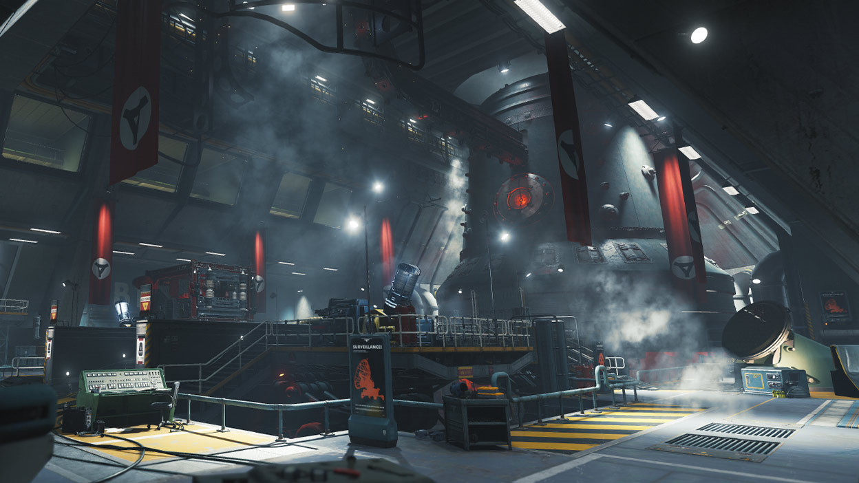 Laser weapon in the middle of a steamy warehouse full of red banners