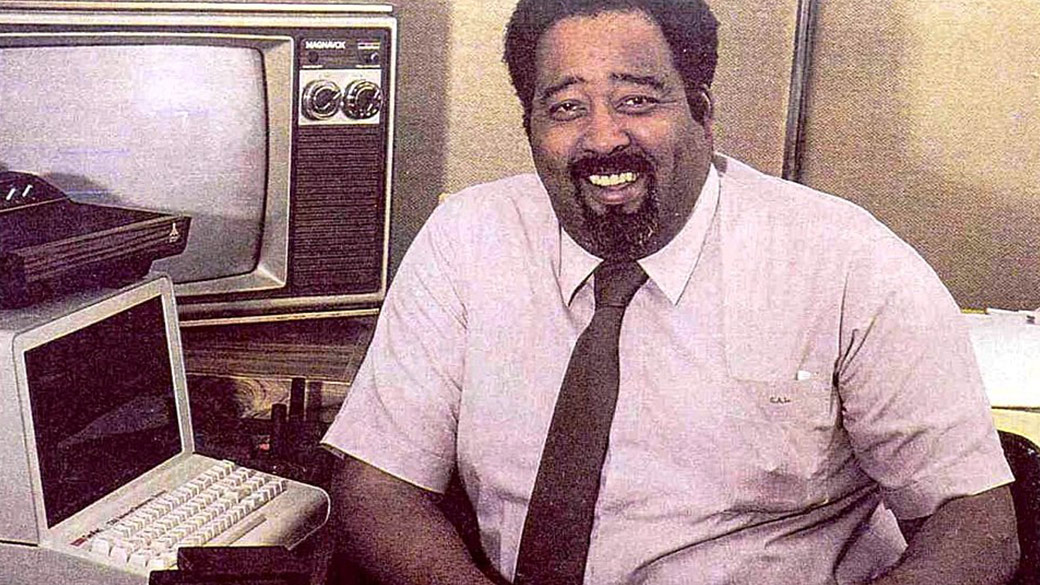 Jerry Lawson sits in front of computer