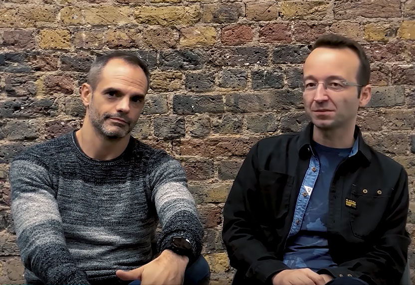 Alexis Corominas and Jordi Ministral of Piccolo Studio sit together in front of a brick wall.